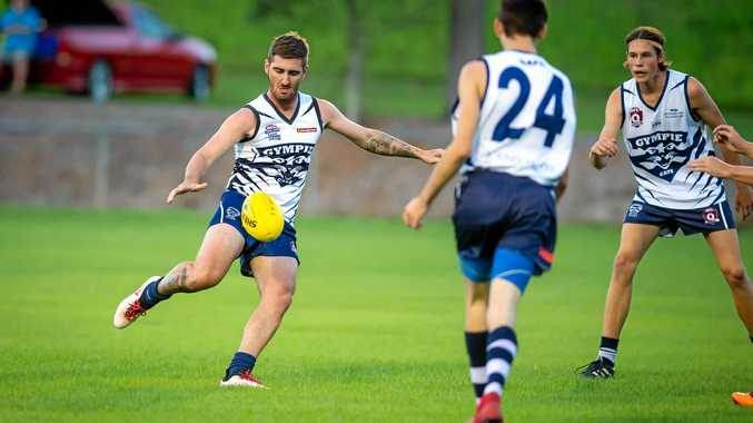 FLYING HIGH: Jesse Lawrence (kicking) bagged 8 majors in a scintillating performance against Maryborough last weekend.