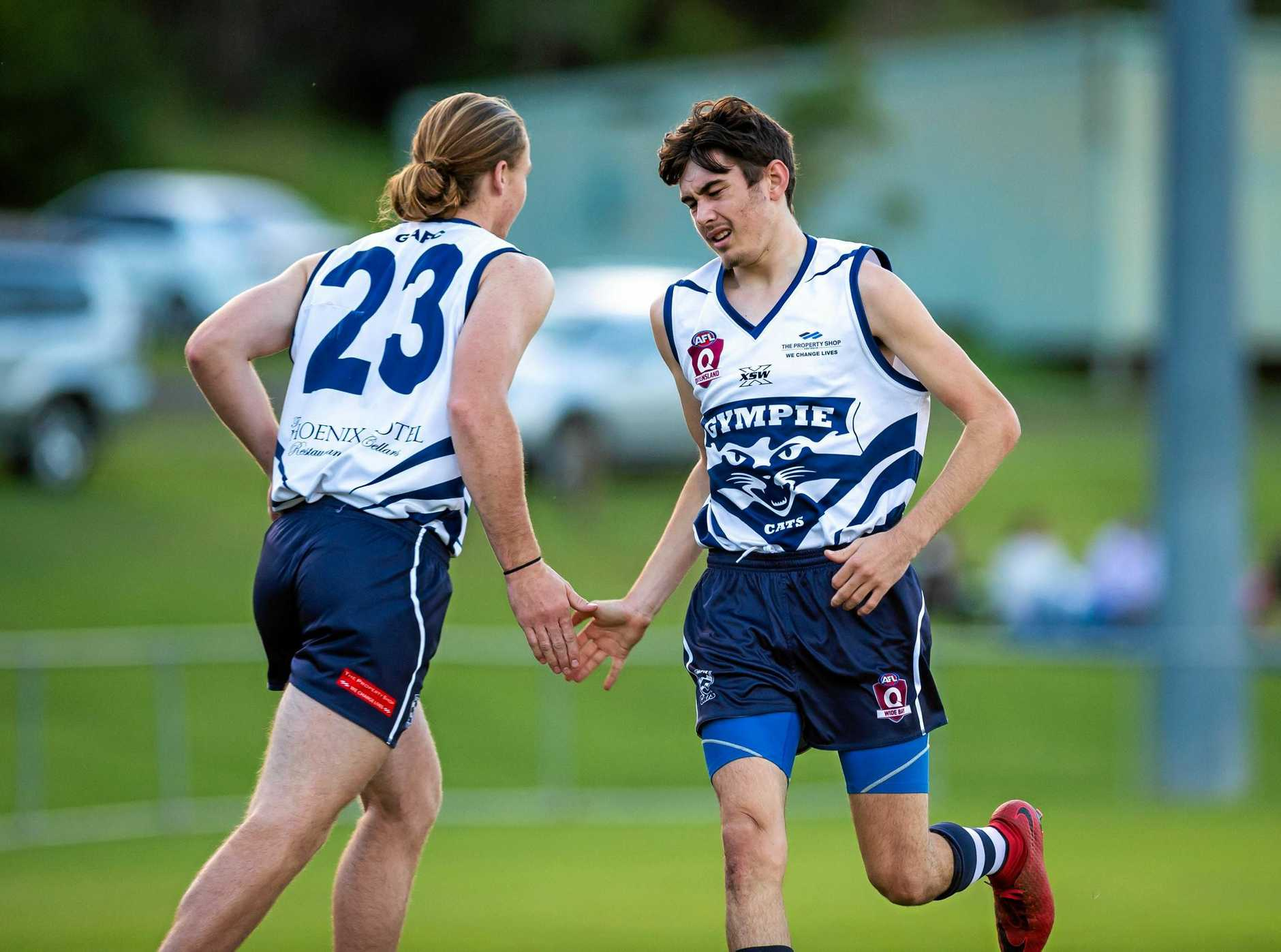 Australian Football - Gympie Cats vs The Waves Bundaberg -  Jack Hayes going on for Troy Cunningham Gympie Cats