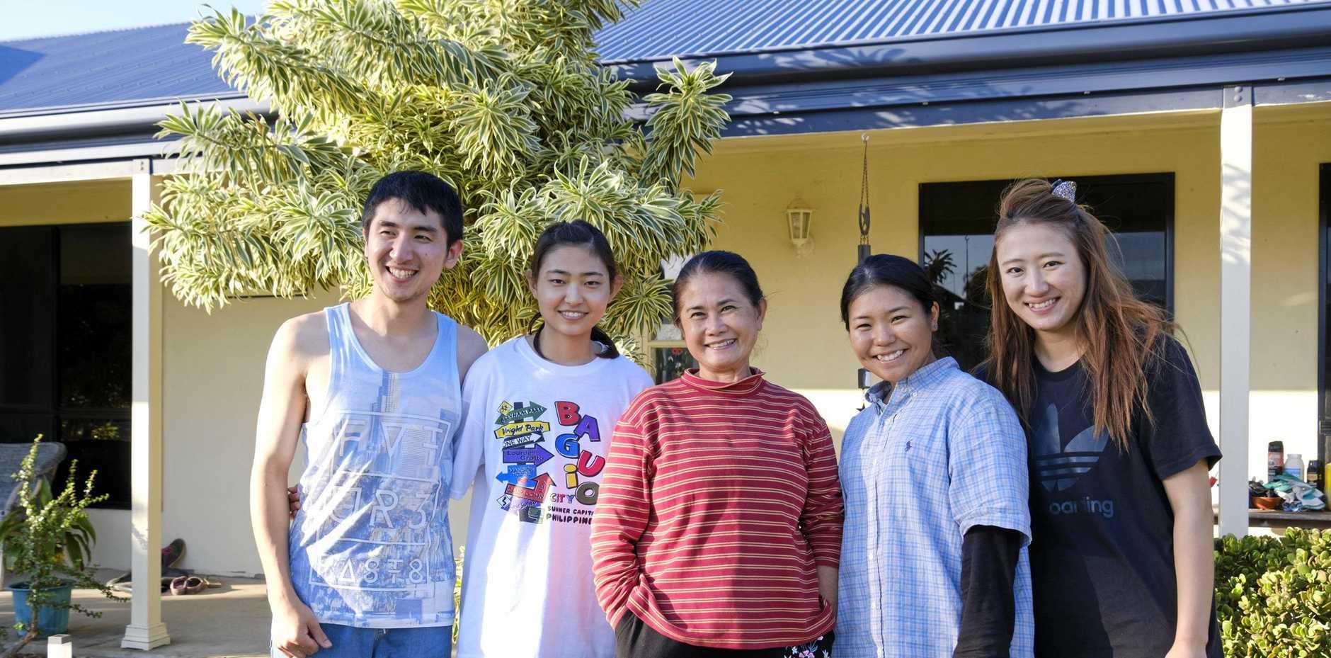 SHORT STAYS: Lee Pendleton (centre) with current boarders Manu Lee, Heekyung Oh, Shizuka Rebecca Goeku, Kayu Hayashi.