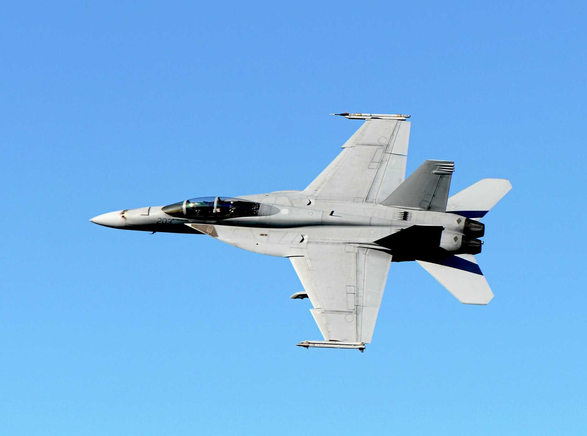 Pilots from 82 Wing based at Amberley RAAF Base fly Super Hornets from the south towards the Evans Head Air Weapons Range during a training exercise.