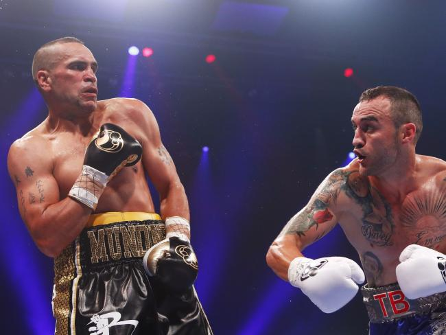 Anthony Mundine evades a punch from Tommy Browne.