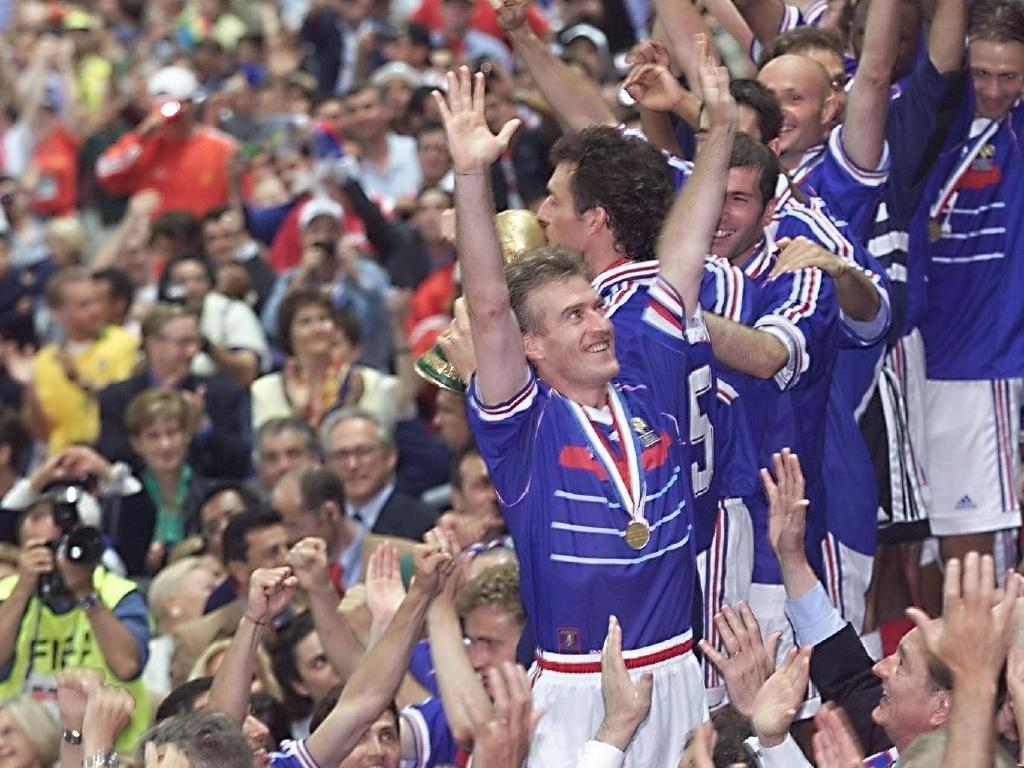 Didier Deschamps and his teammates celebrate their win in the 1998 World Cup final.