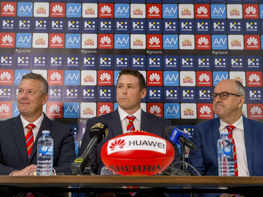 Gold Coast Suns CEO Mark Evans, senior coach Stuart Dew and chairman Tony Cochrane. Picture: Jerad Williams