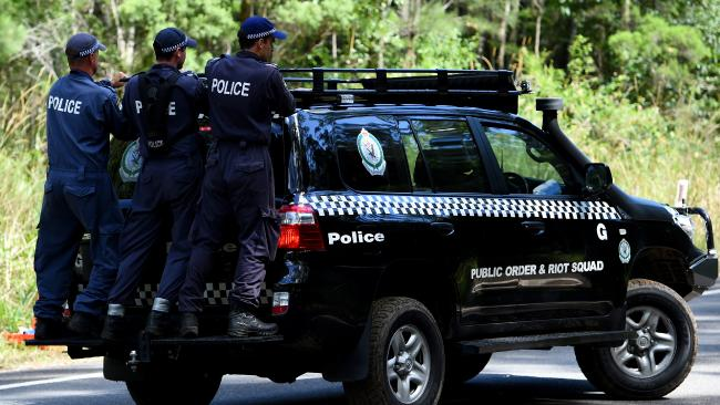 NSW Public Order and Riot Squad Police search near Bonny Hills on the NSW mid-north coast in March, 2015. Picture: AAP/Dan Himbrechts