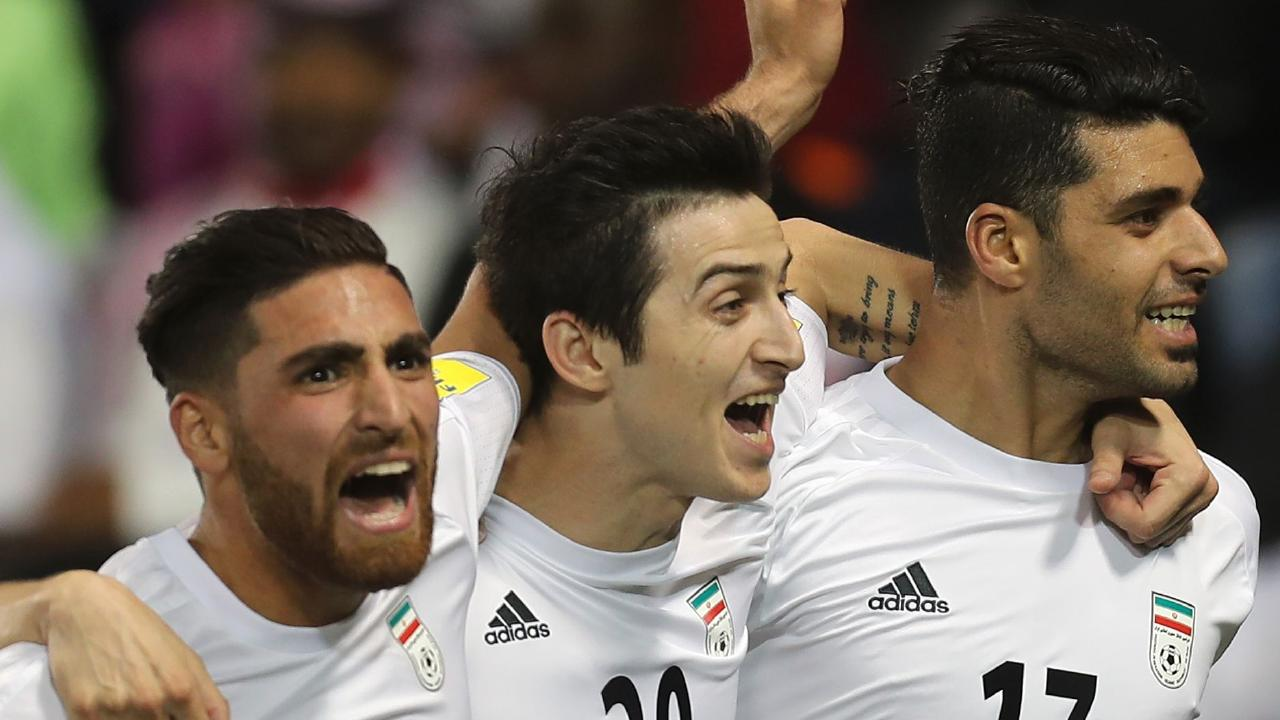 (FILES) In this file photo taken on March 23, 2017, Iran's Mehdi Taremi (R) celebrates with his teammates Sardar Azmoun (C) and Alireza Jahan Bakhsh after scoring a goal during the World Cup 2018 Asia qualifying football match between Qatar and Iran at the Jassim Bin Hamad stadium in Doha. / AFP PHOTO / Karim JAAFAR