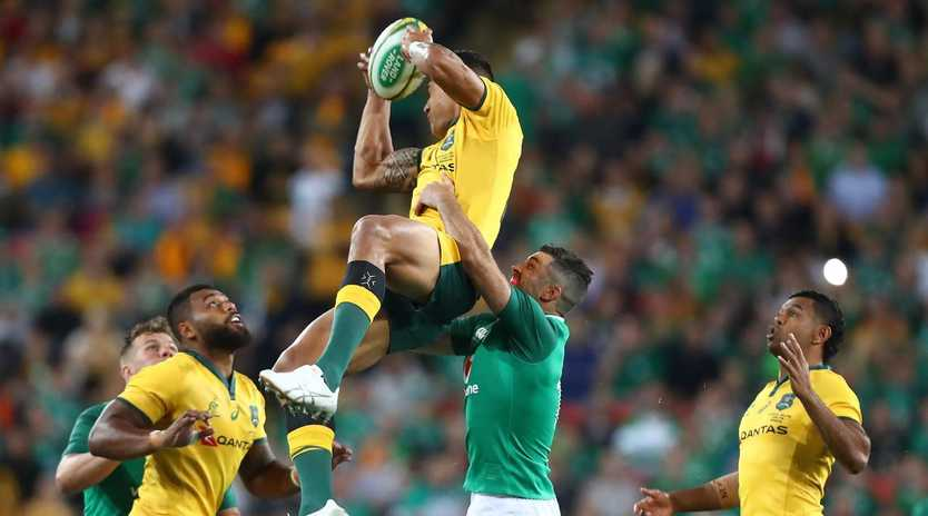 Israel Folau climbs high to claim a catch against Ireland. Picture: Getty Images