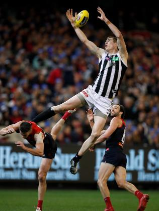 Mason Cox flies high for a grab. Picture: Adam Trafford/AFL Media/Getty Images