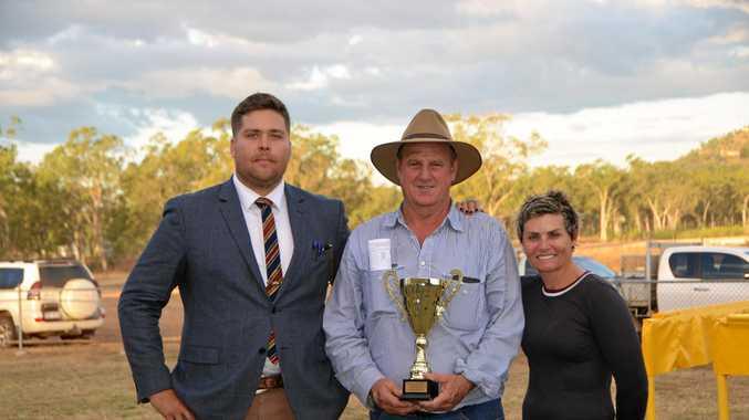 GRINNERS: Gayndah Jockey Club president Stuart Kirk with winning trainer Bob Murray and jockey Cecily Eaton.