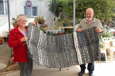 Chris and Ian Robins with their woven mat. The mats are approximately 1.8m x 0.75m made from 700 plastic bags.