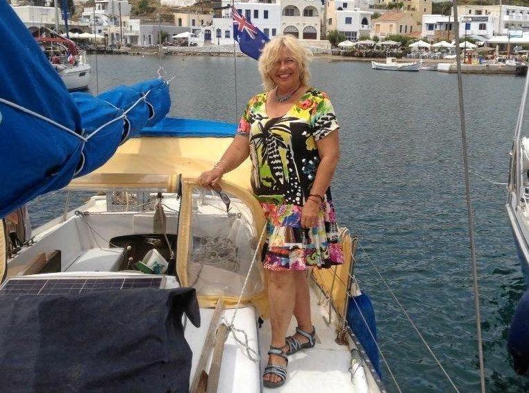 LITTLE BOAT BLUE: Linda Frylink-Anderson on rescued boat Lati in Kythnos, Greece.