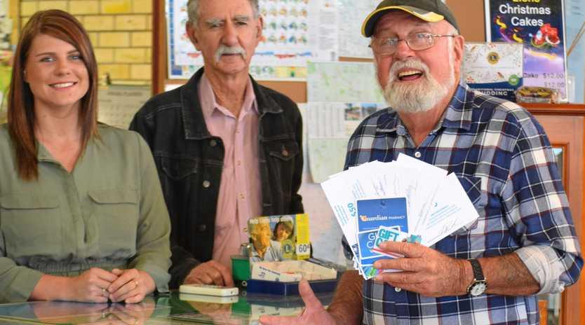 SHOP LOCAL WINNER: Kauri Latza, Bruce Serisier with Buy Shop Local winner John Ogden at Burnett Mapping in Mundubbera.