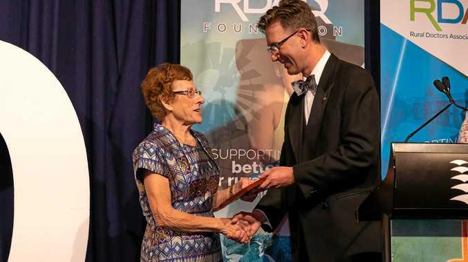 HONOURED: Dr Carmel Walker receiving the RDAQ Meterious Service Award from President, Dr Konrad Kangru.