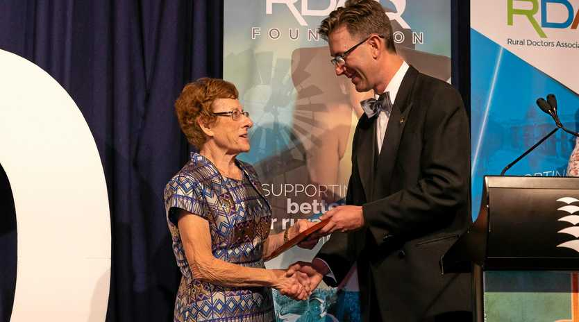 HONOURED: Dr Carmel Walker receiving the RDAQ Meterious Service Award from President, Dr Konrad Kangru.