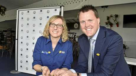 WINTER WONDERLAND: Planting daffodils to signify a new partnership are Cancer Council event coordinator Marianne Harth and Toowoomba Turf Club CEO Blair Odgers.
