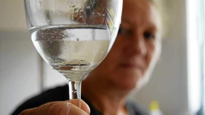 Eton resident fed up with finding sediment in her water.
