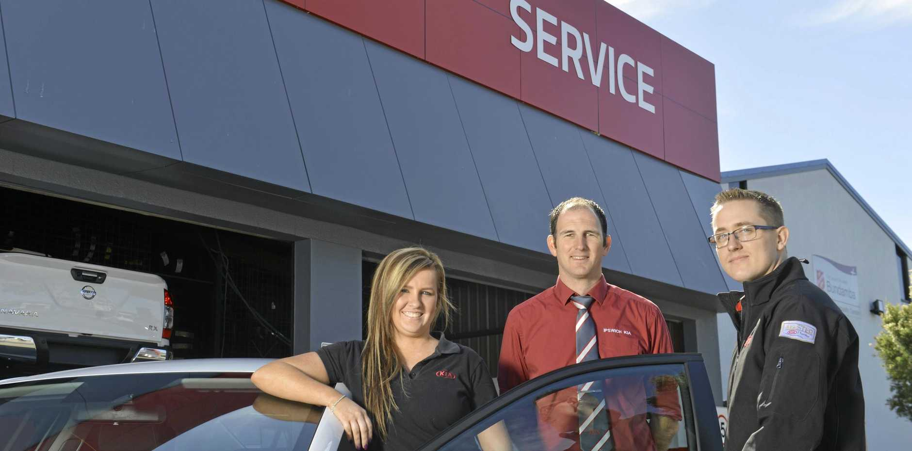 Tamara Avis, service advisor, Andrew Debattista, service manager and Ryan Botfield, Kia master tech for a story about a new service centre which is almost finishedat Bundamba.