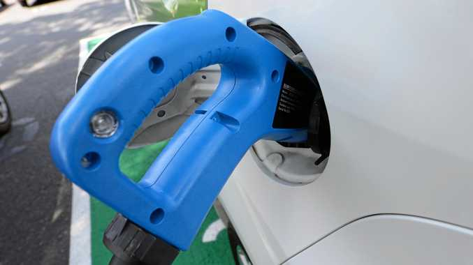 A car is charged at an electric vehicle fast charging station.