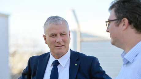 Deputy Prime Minister Michael McCormack meets with Dawson MP George Christensen at Mackay airport.