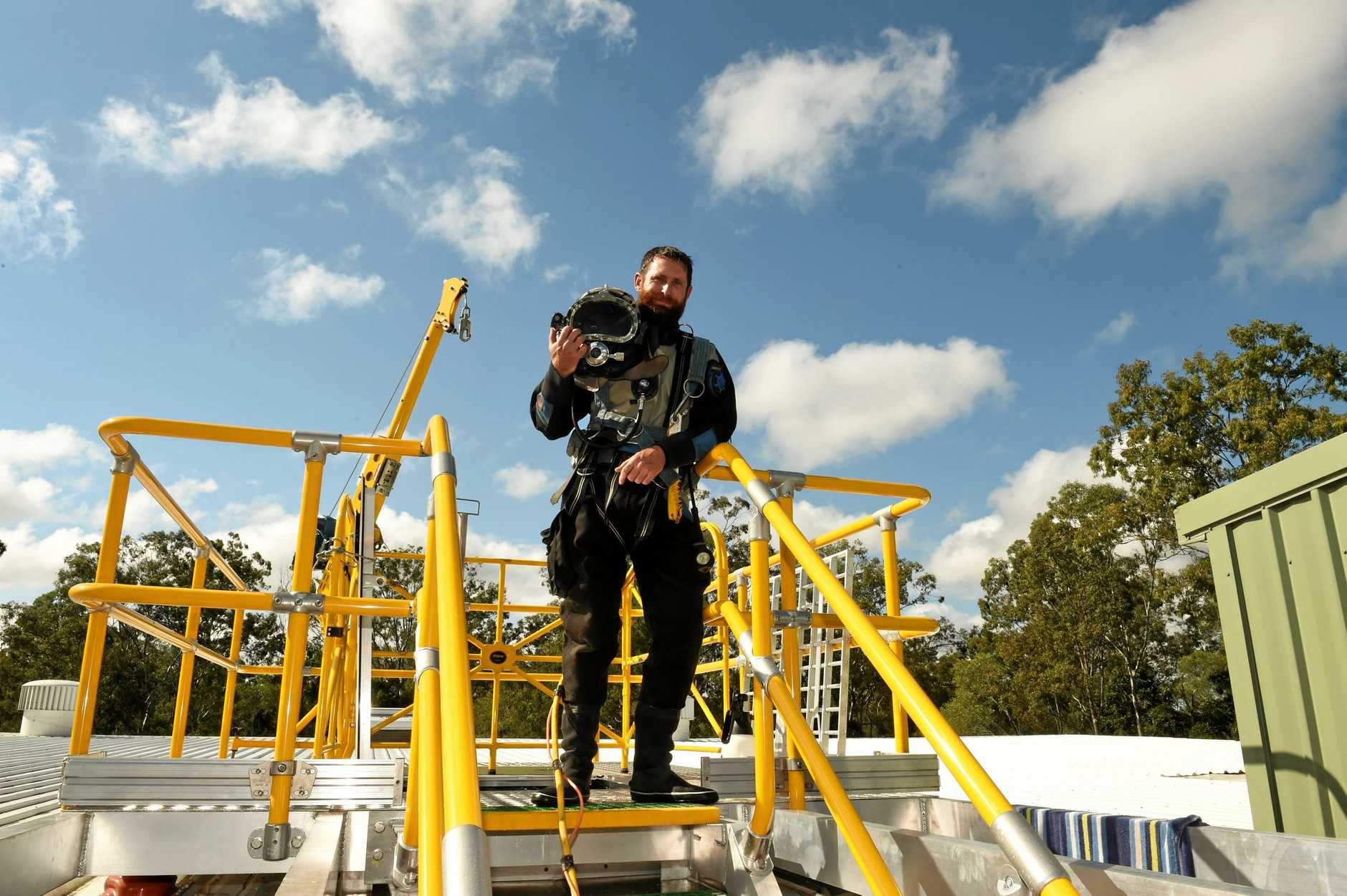 TANK CLEANING: Commercial diver with Waters Marine Tom Fairhall prepares to inspect the Teddington water reservoir on Wednesday. The council is undertaking a regular check-up of reservoirs across the region to monitor their hygiene.