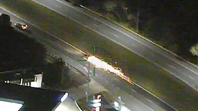 Sparks fly from the stolen vehicle after a wheel fell off.
