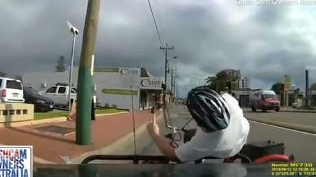 The vehicle rams its bull bar into the cyclist, knocking the bike out from under him.