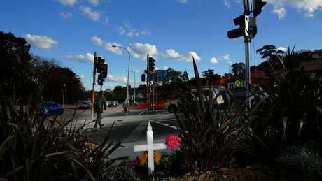 A white cross stands over the crossing where Jo-Ann Thwaites was killed — the intersection of Condamine St and Old Pittwater Rd. Picture: Troy Snook.