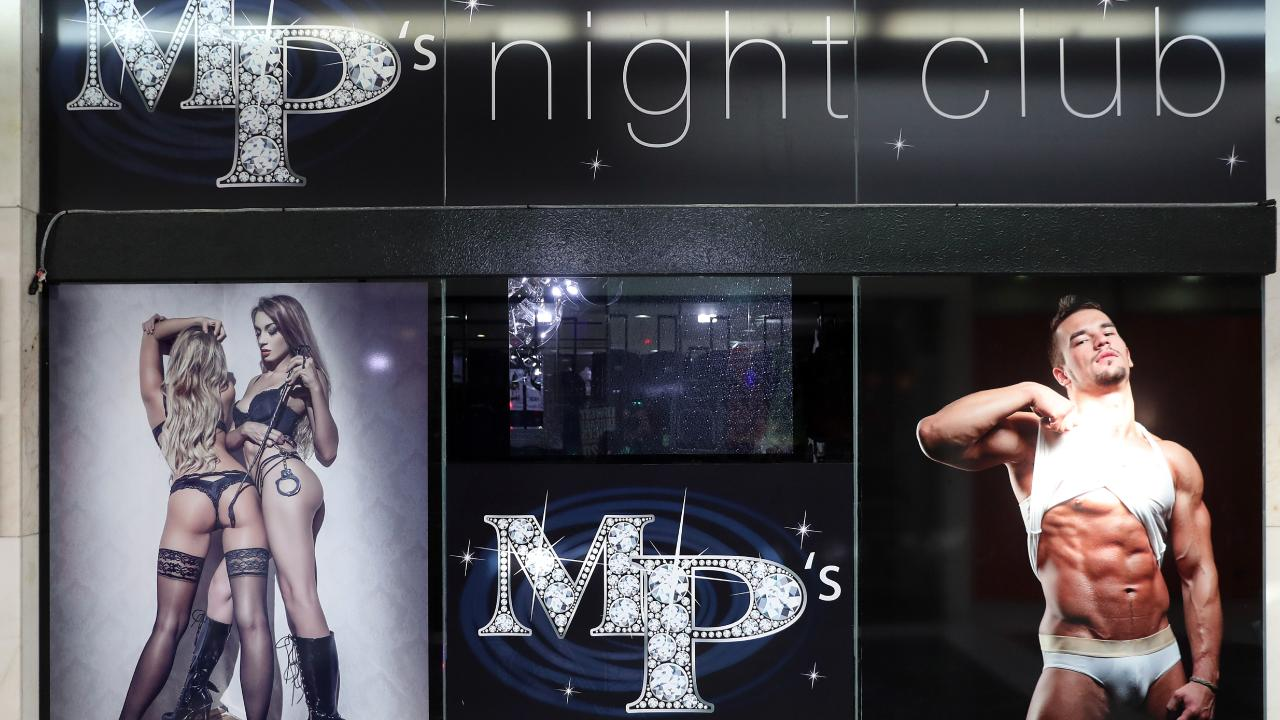 Two outdoor ads showing two women in G-strings and a man in briefs have landed the Gold Coast Nightclub MP's in hot water. Photo by Richard Gosling
