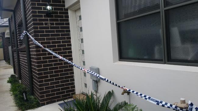 Police tape is draped across Ms Yu's front door. Picture: Ben Graham