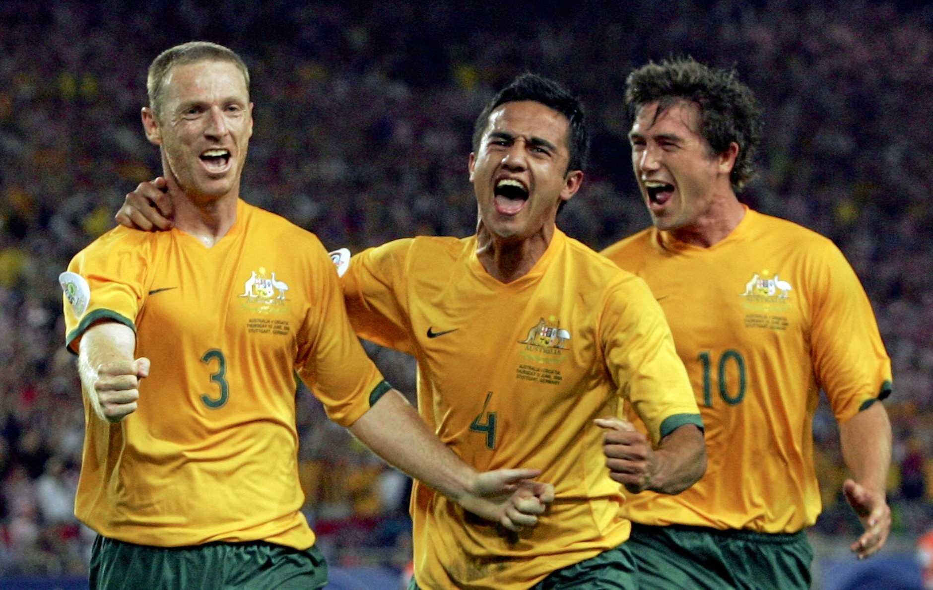STUTTGART, GERMANY - JUNE 22:  Craig Moore #3 (L) of Australia celebrates with teammates Tim Cahill (C) and Harry Kewell (R), after taking a penalty to level the scores at 1-1 during the FIFA World Cup Germany 2006 Group F match between Croatia and Australia at the Gottlieb-Daimler Stadium on June 22, 2006 in Stuttgart, Germany.  (Photo by Robert Cianflone/Getty Images)
