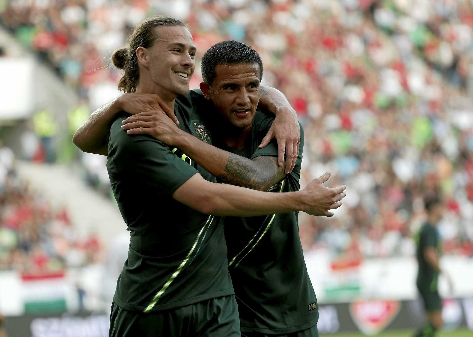 Socceroos Jackson Irvine (L) and Tim Cahill celebrate after the Hungarians scored an own goal during the Socceroos v Hungary friendly at Groupama Arena in Budapest.