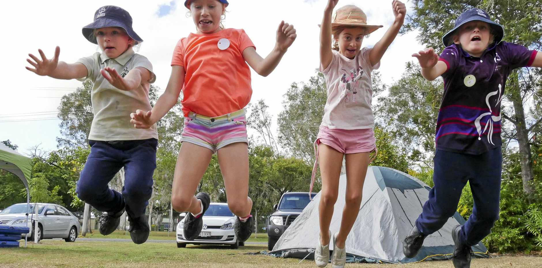 SISTERSHIP: Bowen lone guide Brianna Ninnes, 9, with Proserpine guides Brittney Cram, 9, and Emily Jackson, 10, and Bowen lone guide Keeley Ninnes, 10, at the Proserpine Guide Hall on Saturday.