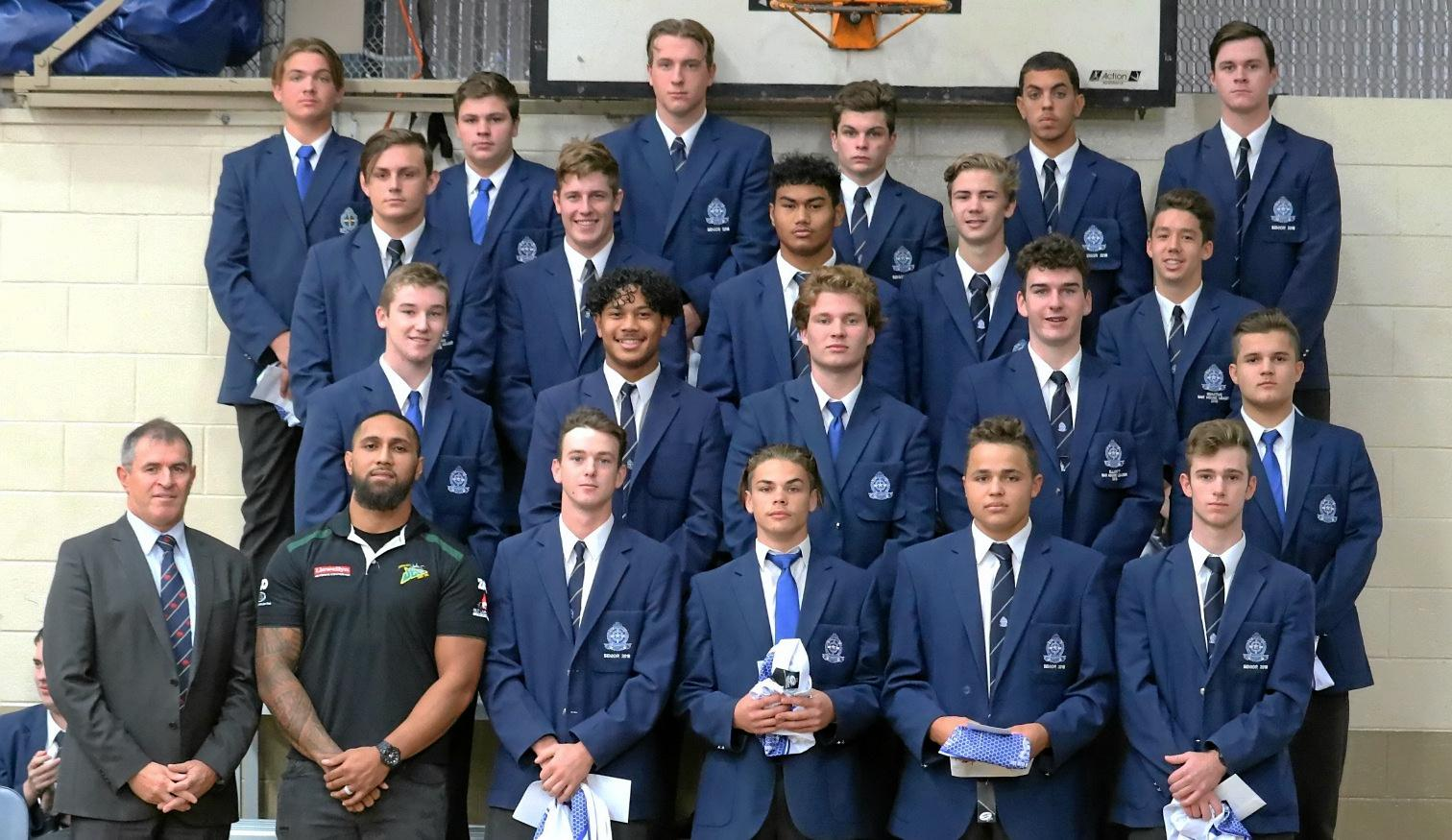 Ipswich Jets player and St Edmunds old boy Tyson Lofipo  handed out the jumpers to the school's Confraternity team before they travel to Charters Towers.