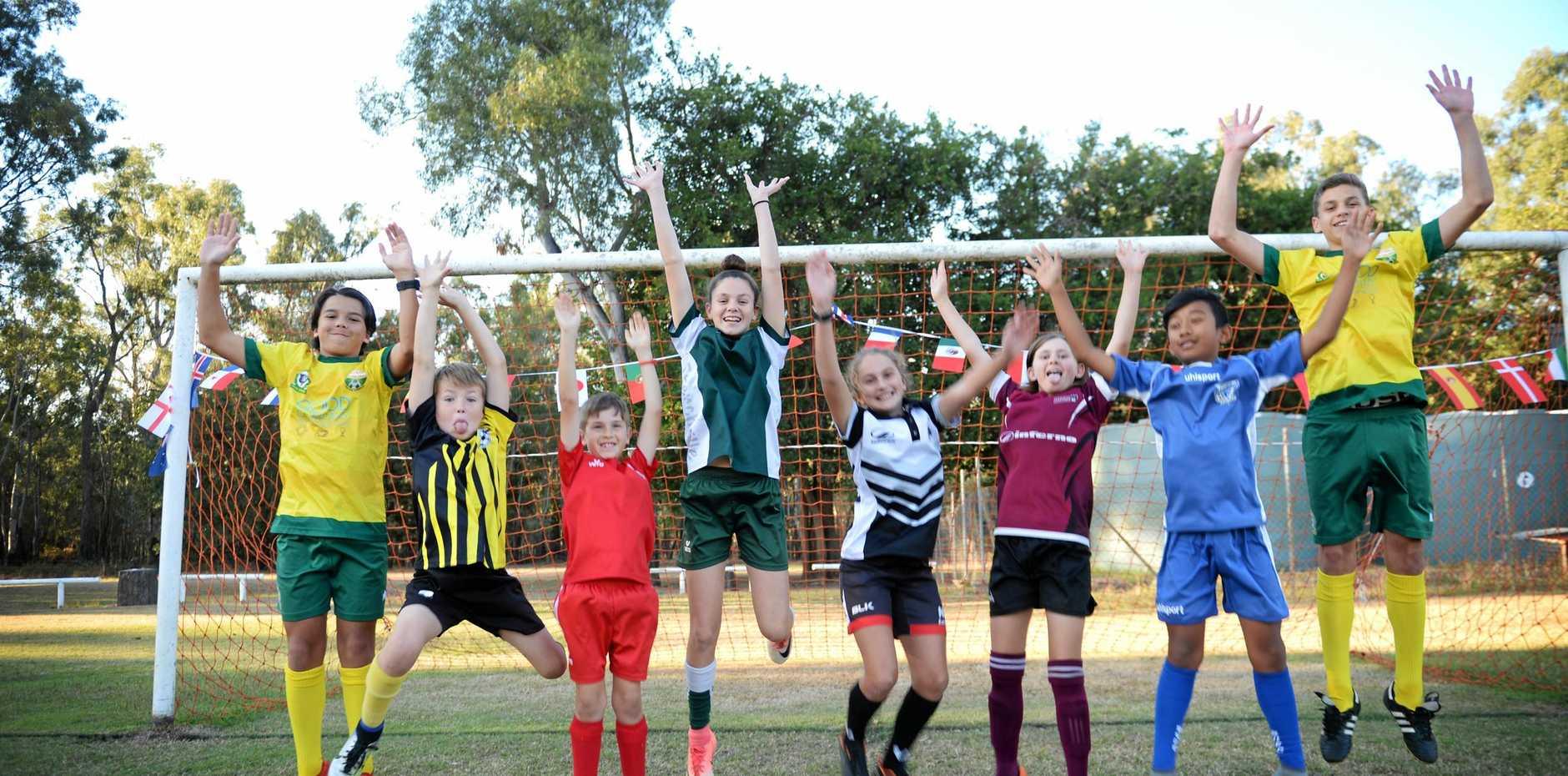 GO BOYS! Rockhampton footballers Tana Martin, Nate Neilsen, Riley Clarke, Miia Anderson, Isbella Blomfield, Aniesa Law, Sonam Lama and Jardel Bob are ready to cheer on the Socceroos in the 2018 FIFA World Cup.