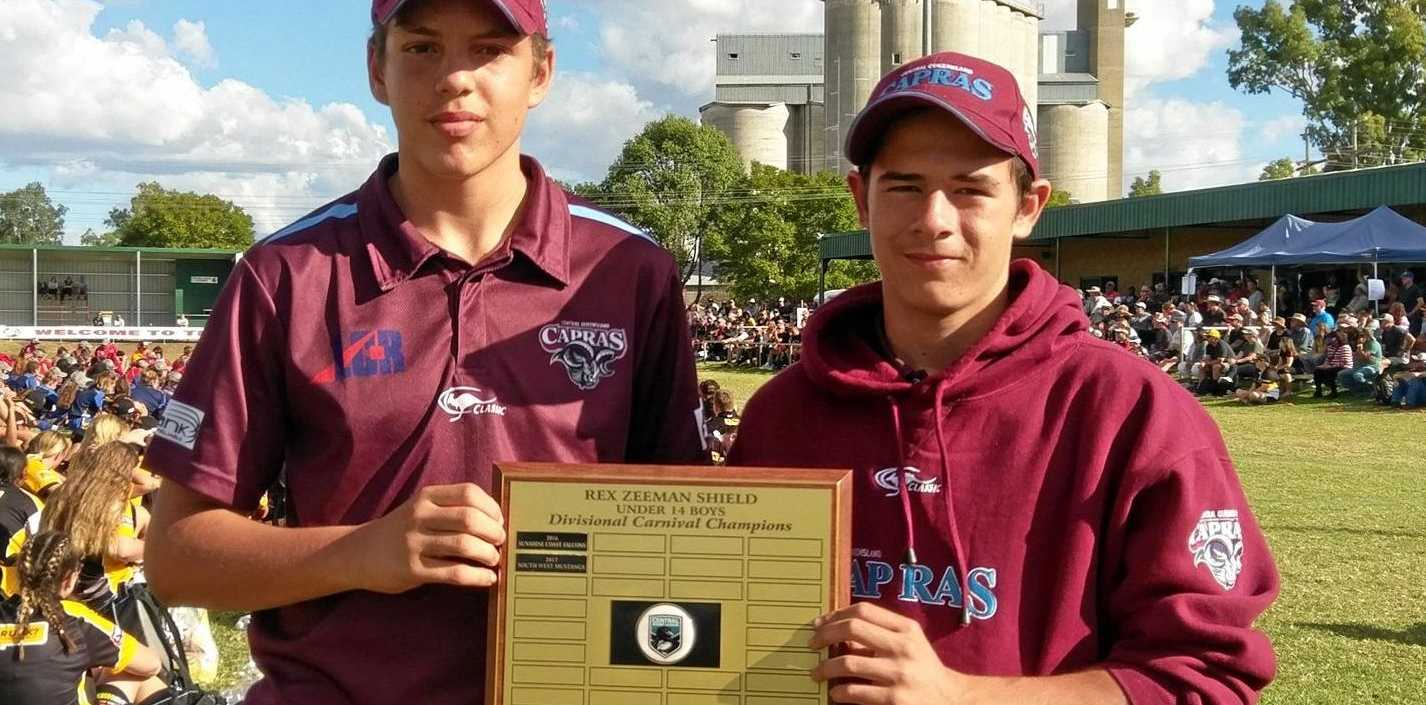 CQ Capras under-14 captain Kelly Shadlow (left) and vice-captain Bailey Smith with the Rex Zeeman Shield.