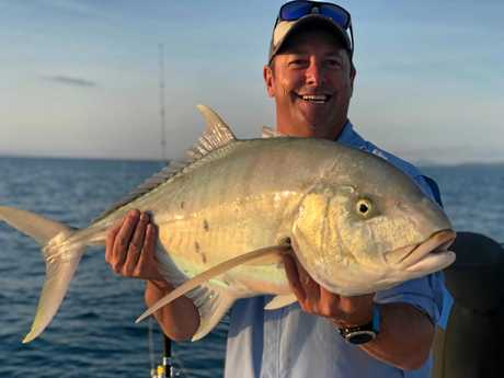 HUGE CATCHES: Creek to Coast presenter Scotty Hillier with one of three golden trevally caught on Wednesday fishing with micro jigs around Seaforth.