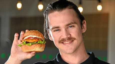 22 year old Sam Elliot with his Vegetarian burger at Familiar Takeaway, Casuarina. Picture, John  Gass