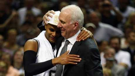 Gregg Popovich celebrates with Patty Mills after the Spurs' 2014 NBA title win.