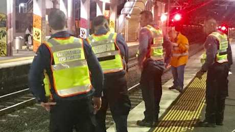 Rail crews and emergency services at Virginia railway station. Picture: Steve Pohlner