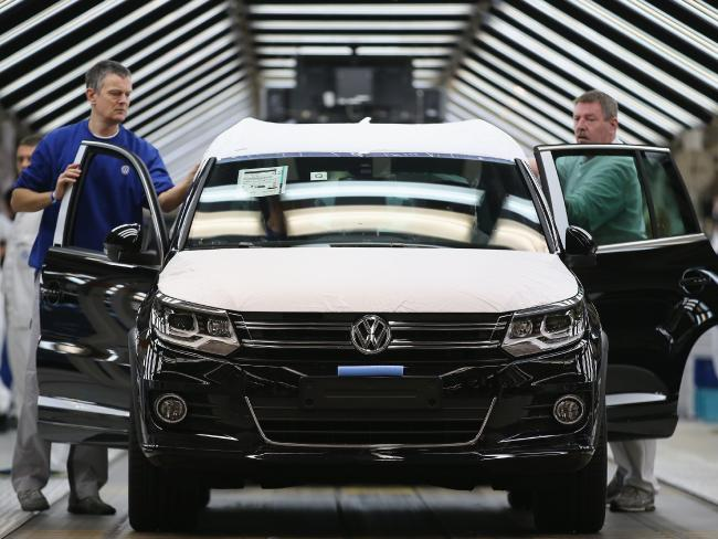 Workers inspect finished Volkswagen cars. The company installed emissions-cheating software into 11 million cars. Picture: Sean Gallup/Getty Images