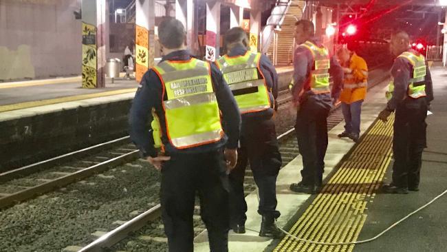 Rail crews at Virginia railway station. Picture: Steve Pohlner