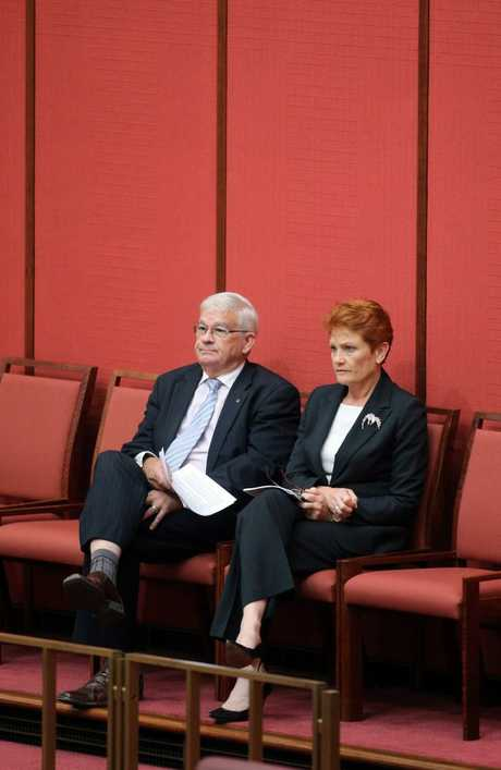One Nation Senator Pauline Hanson with NSW senator Brian Burston in the Senate chamber in Parliament House in Canberra. Picture: Gary Ramage