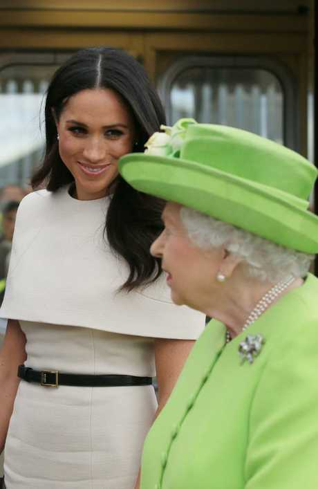 Meghan Markle looks relaxed with Queen Elizabeth II at Runcorn Station. Picture: Getty