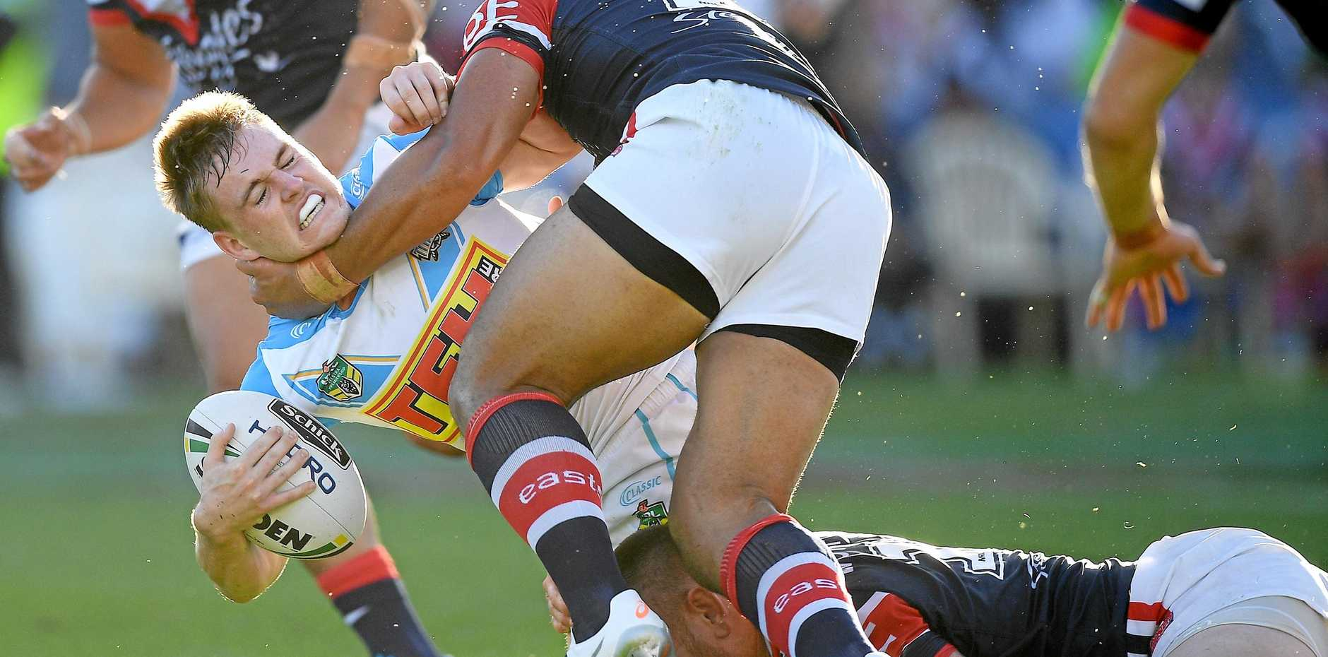 The Titans' AJ Brimson is tackled by the Roosters' Isaac Liu and Jared Waerea-Hargreaves in Gosford on May 26 last year.  Picture: Dan Himbrechts/AAP