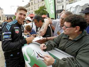Warwick driver signs autographs at world's biggest race