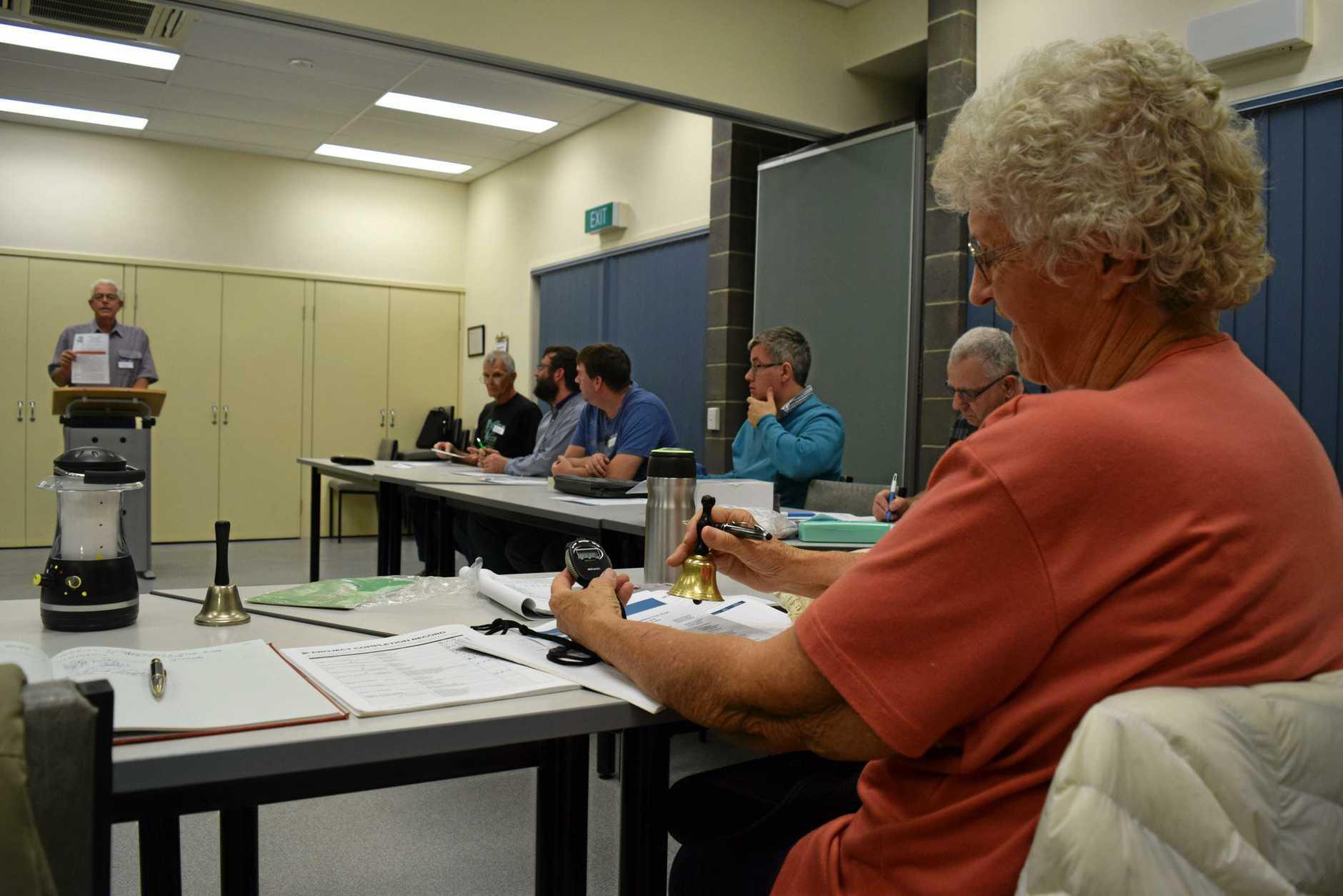 Weblec Toastmaster Anne Gilbert keeps time for speakers during their weekly meetings.