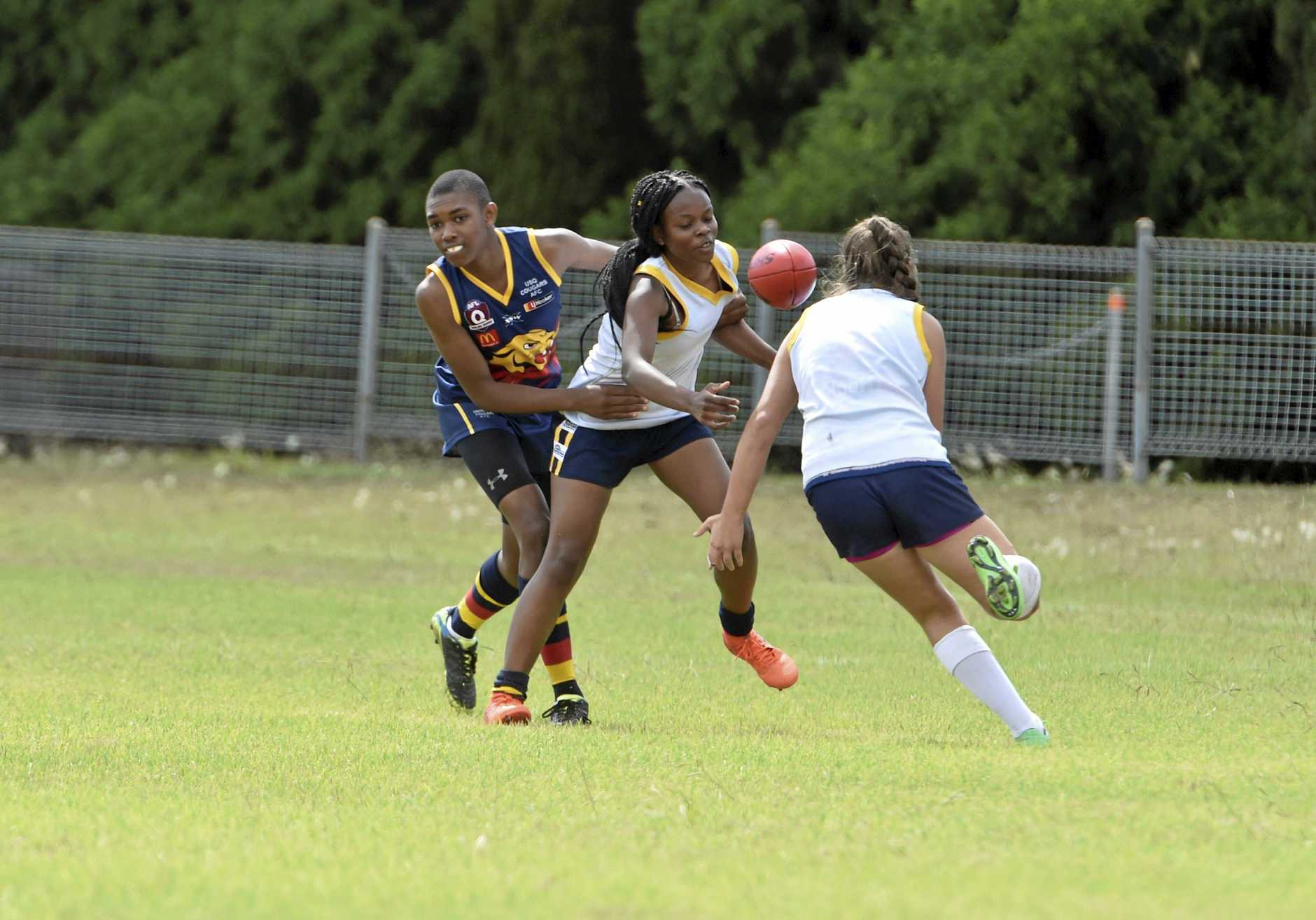 FINE FORM: Nyengela Mwajuma (middle) booted home three goals for the USQ Cougars in their win over South Toowoomba in the Westpac Cup last weekend.