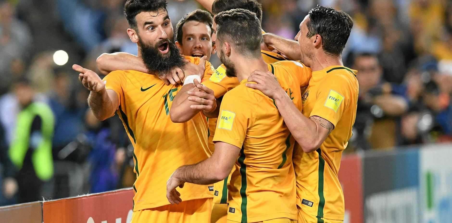 Australia's Mile Jedinak (left), celebrates after scoring against Honduras during the 2018 FIFA World Cup Intercontinental play-off football match between Australia and Honduras at Stadium Australia in Sydney, Wednesday, November 15, 2017.(AAP Image/Brendan Esposito) NO ARCHIVING, EDITORIAL USE ONLY