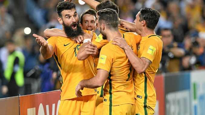 BIG NIGHT: Australia's Mile Jedinak (left), celebrates after scoring against Honduras. Willowburn Football Club will have Australia's match against France live on the big screen tonight.