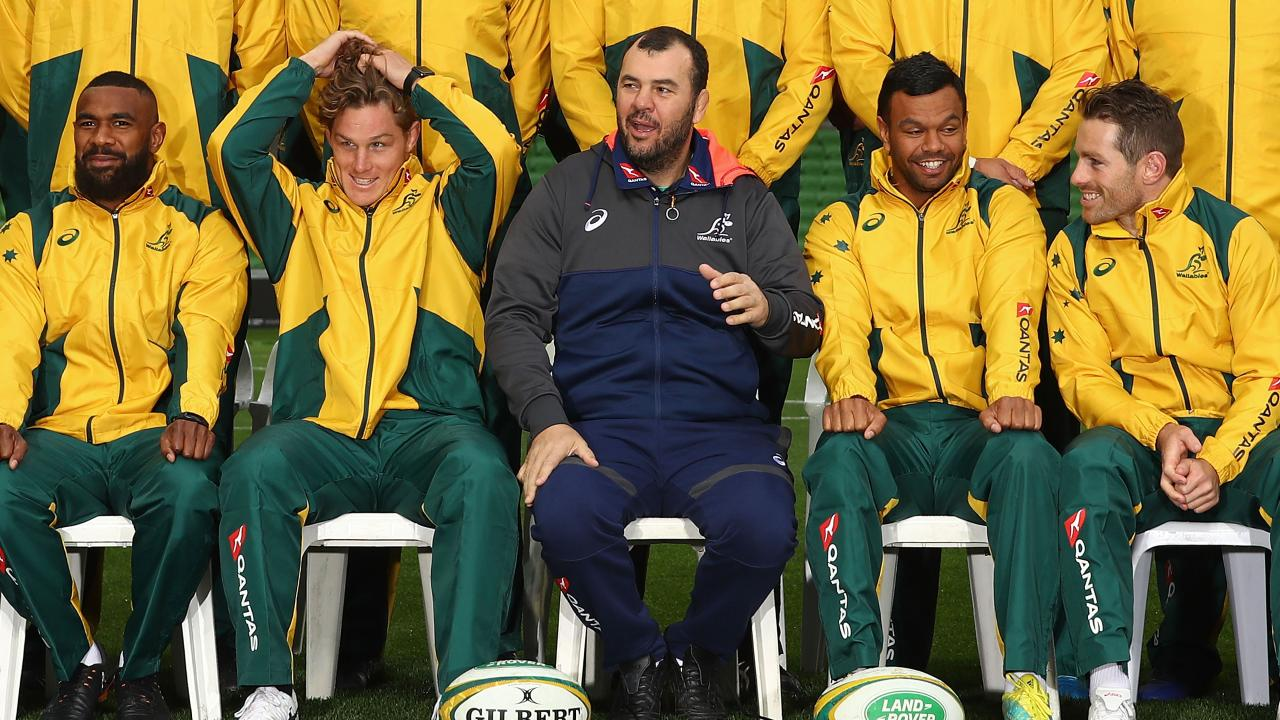 Michael Cheika (C) and his Wallabies won't waste time targeting Johnny Sexton.