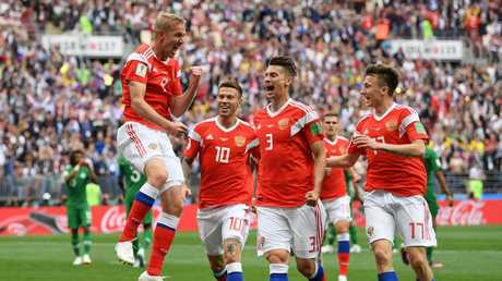 Iury Gazinsky of Russia celebrates with teammates Fedor Smolov, Ilya Kutepov and Aleksandr Golovin after scoring the opening goal. Picture: Getty Images